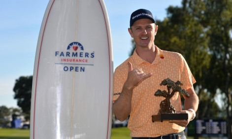 Jan 27, 2019; San Diego, CA, USA; Justin Rose poses with the winner's trophy following the Farmers Insurance Open golf tournament at Torrey Pines Municipal Golf Course - South Course. Mandatory Credit: Orlando Ramirez-USA TODAY Sports
